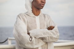 FUTURE LIFE. September 2016. Kelvin (25, from Nigeria), portrayed on board the humanitarian rescue vessel Aquarius moments after having been rescued from a rubber boat in distress adrift at sea. Often soaked with a skin-burning mix of fuel and salty sea water, the clothes worn by migrants need to be immediately replaced after the rescue.